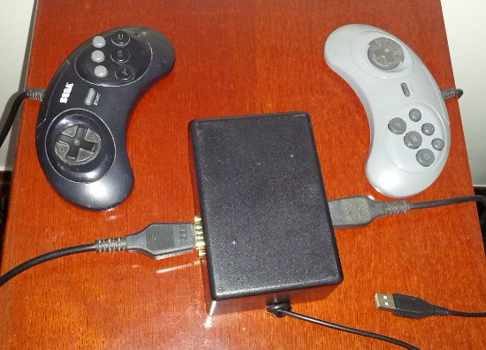 Picture of the finished box with two SEGA Mega Drive controllers connected to it.