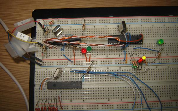 USBasp on a breadboard, together with the bliking LEDs circuit.